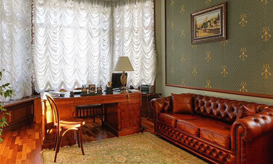 Motifs gold wallpaper for walls adds the right amount of elegance, and the green helps in keeping the design subtle