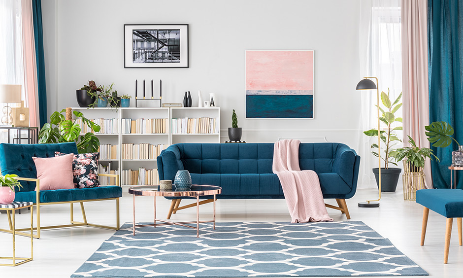 Blush pink living room accessories, be it curtains, planters, photographs, and paintings, help create a stunning living room