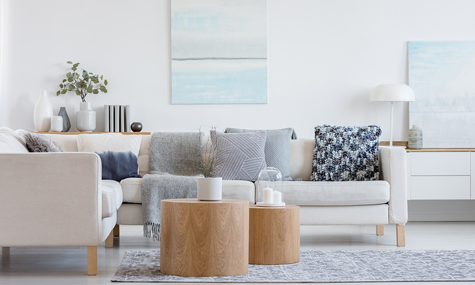 White living room accessories list bright white lamps, textured pastel paintings, scented white candles look pristine.