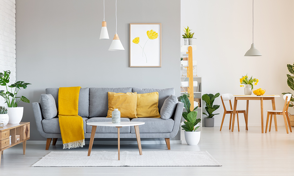 Yellow living room accessories look incredibly mesmerizing, yellow cushions and vases to add some sunshine in living room