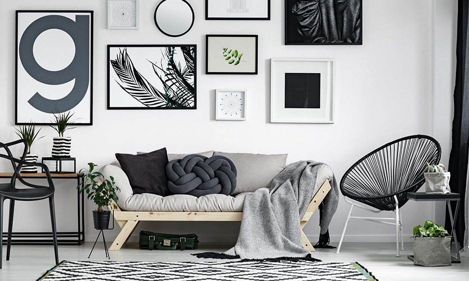 Black and white living room accessories like rugs, solid paint print art, and typo frames make a great impression.