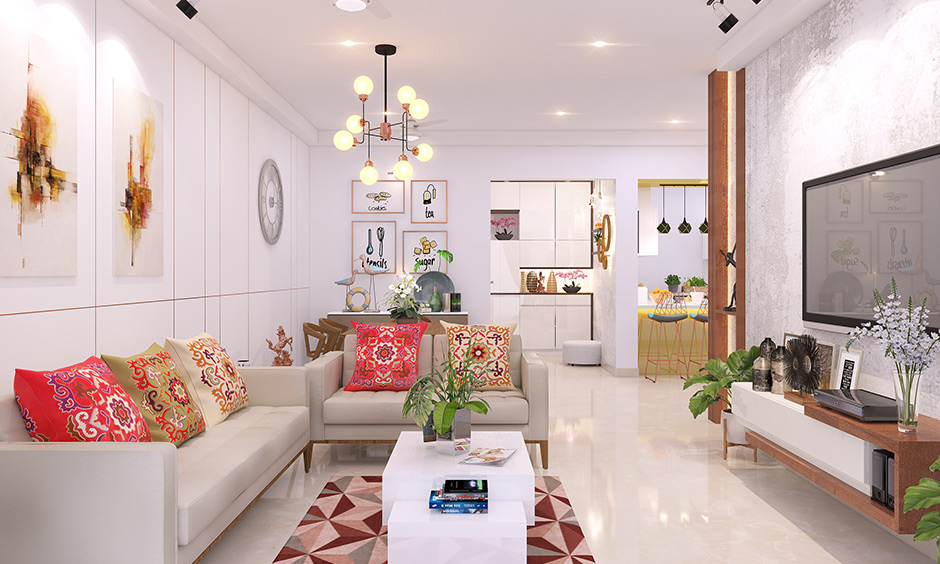 Brighten up your walls with white interior design with vitrified tiles, walls, and a tv unit all in white