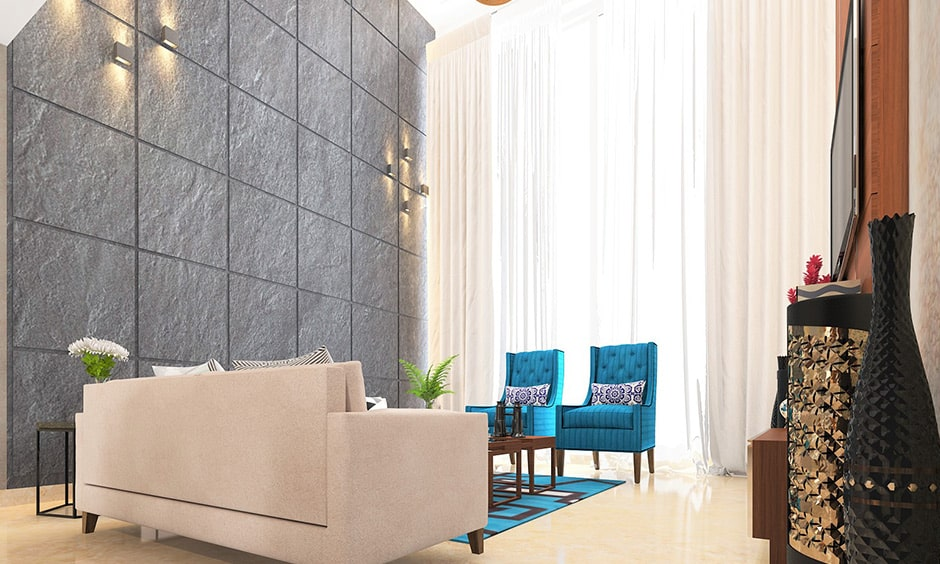 Grey colour of the wall gives a class and elegance look to your living room