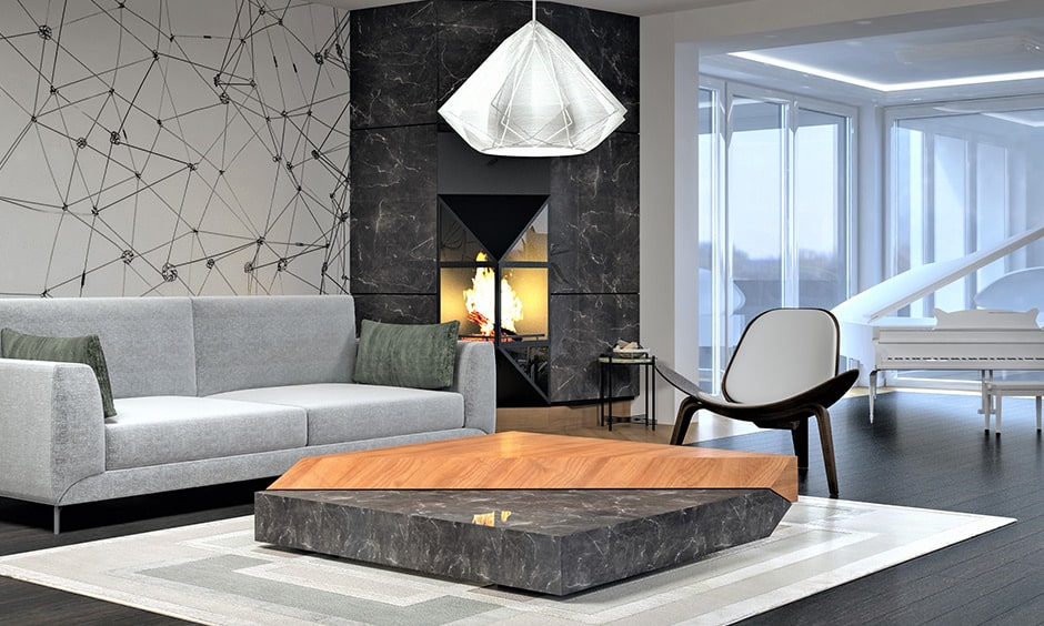 Grey living room with grey marble walls of the fireplace and patterned accent wall
