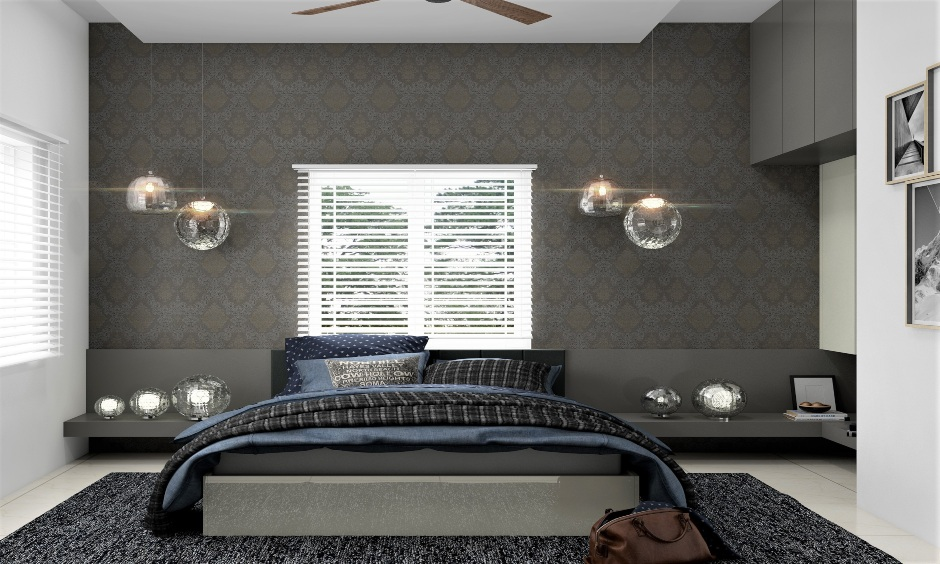 Light grey low floor double bed with disco-themed hanging lights and table accessories is bold and sophisticated