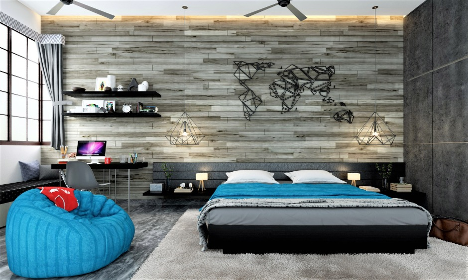Black low floor bed designs with the grey-themed interior and handcrafted steel world map on the wall give satisfaction