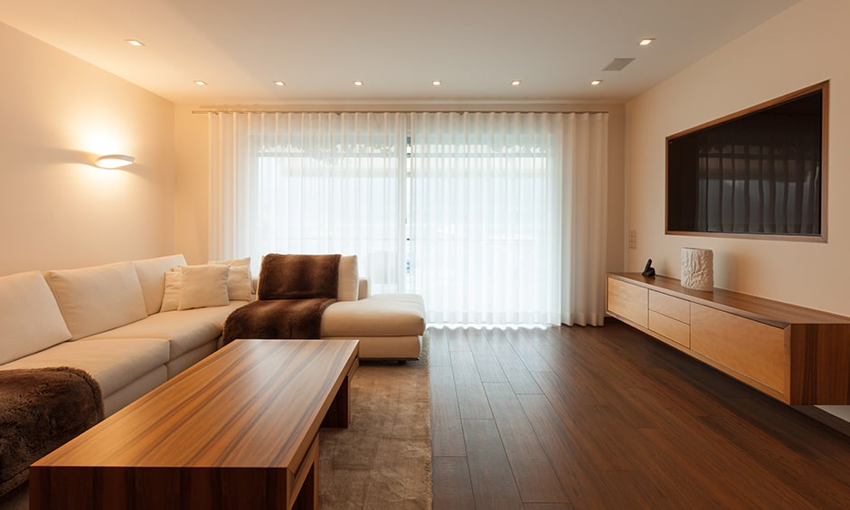 Contemporary living room with wooden tv consoles and coffee tables