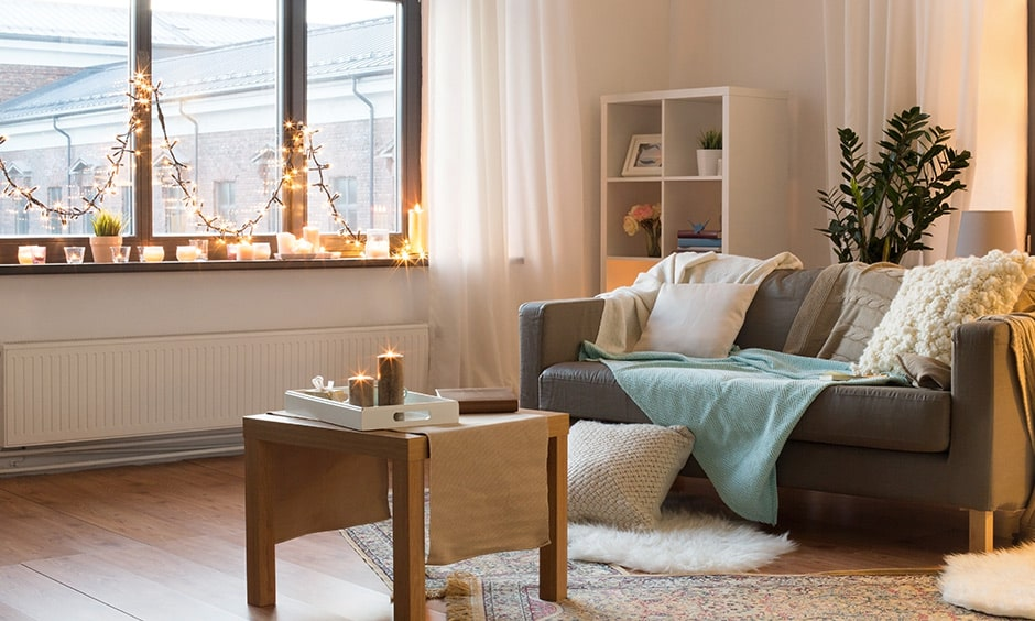 Monsoon home decor in living room with scented candles and fairy lights