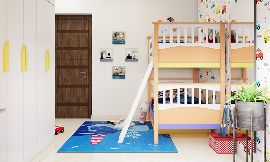 Colourful kid bunk beds with vertical slat headboard placed neatly in this white bedroom.