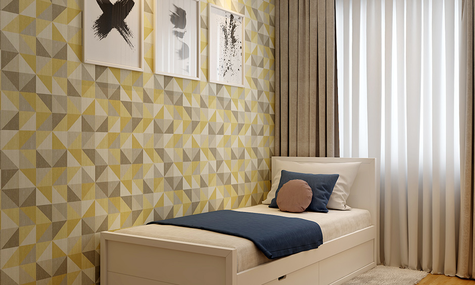 Cream colour mattress and blue blanket with pull out storage options are types of single beds for small rooms.