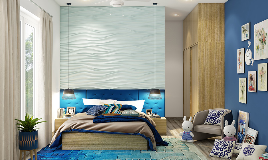 Custom plush bedroom rugs in shades of blue with the headboard at the top