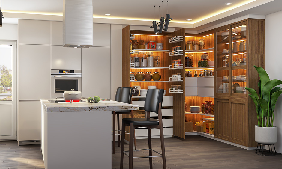 Island white kitchen with wooden tall unit interiors customised on storage/ organisation requirements and style preferences