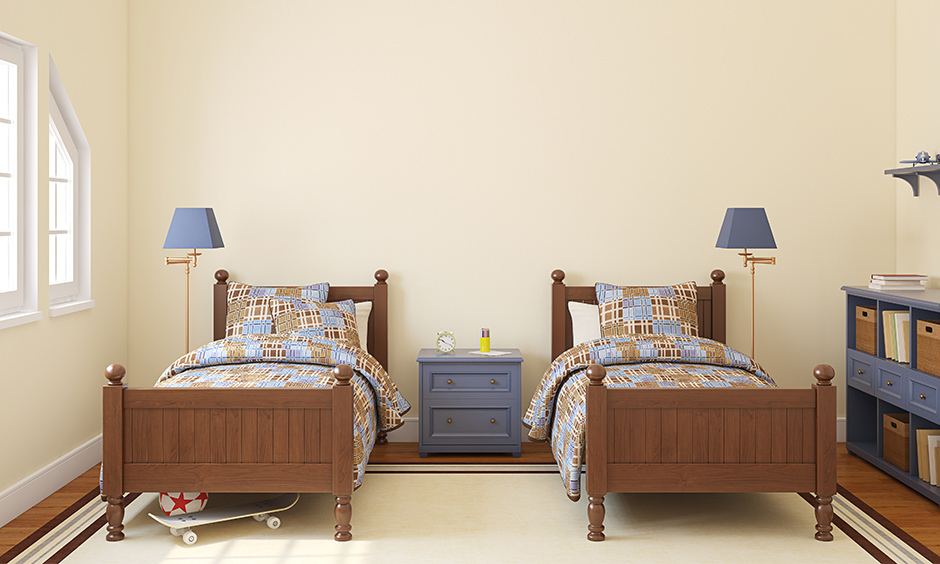 Boys twin bedroom set made from dark wood and twin lampshades