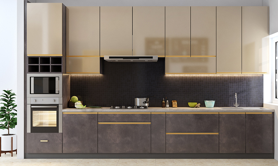 Industrial single wall kitchen design with the sparkle of gold-finished cabinets and gold railings looks luxury
