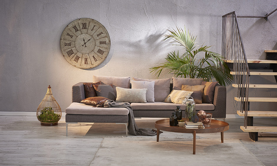 Modern vintage house with a large antique clock in roman numerals adds character to this living room.
