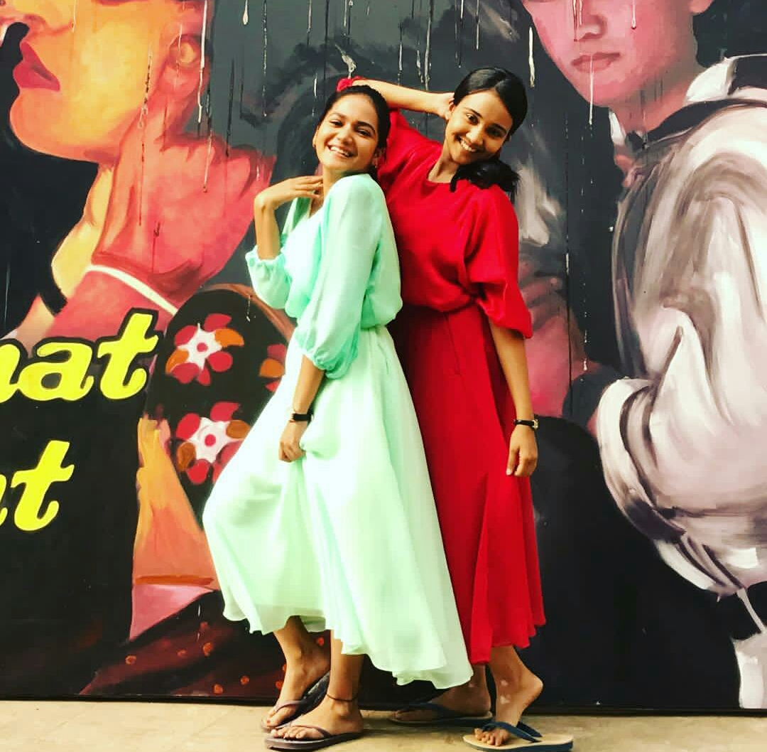 Ayesha Kaduskar And Ashi Singh As Cousins Preeti And Naina Agarwal In Front Of Qayamat Se Qayamat Tak Poster