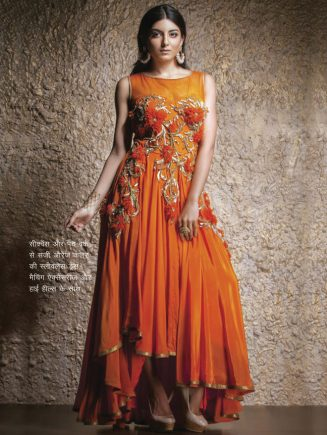 Orange color sleevless dress decorated with sequins and patch work