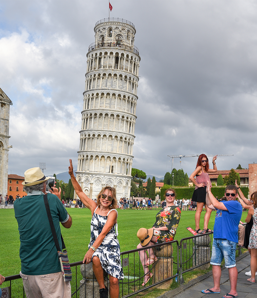 Has social media ruined the beauty of travel - Tourists at the Leaning Tower of Pisa, Italy