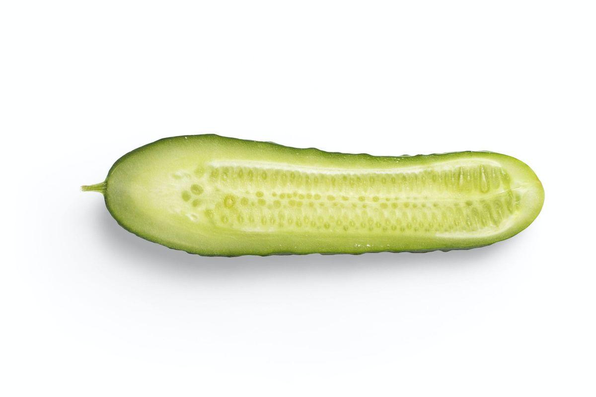 cut cucumber against white background