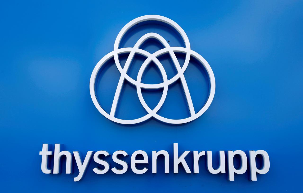FILE PHOTO: Thyssenkrupp's logo is seen close to the elevator test tower in Rottweil, Germany, September 25, 2017. REUTERS/Michaela Rehle/File Photo