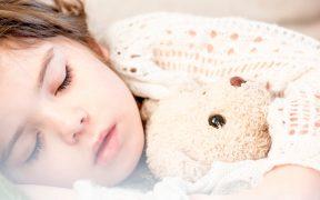 girl-sleeping-with-toy