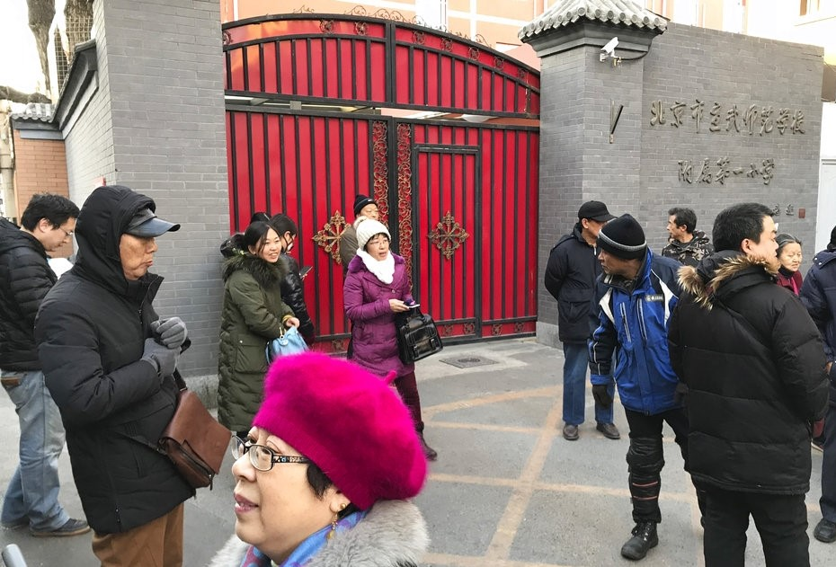 Worried parents outside Chinese primary school