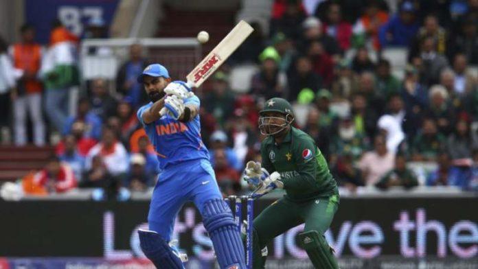 India vs Pakistan: rain stops play, Virat Kohli sails India above 300