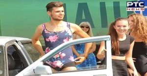 Woman And Men colorful bikini wearing pumps take Petrol free In Russia