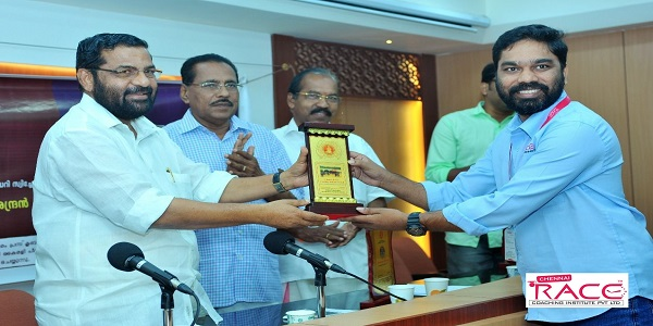 Mr. madhan Seeman Deputy Director of Chennai RACE Coaching Institute P Ltd receiving award at Kerala