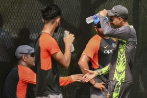 sports news pakistani cricketor malik shake hands with dhoni during practice match in dubai