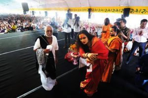 Morari-Bapu-visits-Kamathipura-invites-sex-workers-for-ramayan