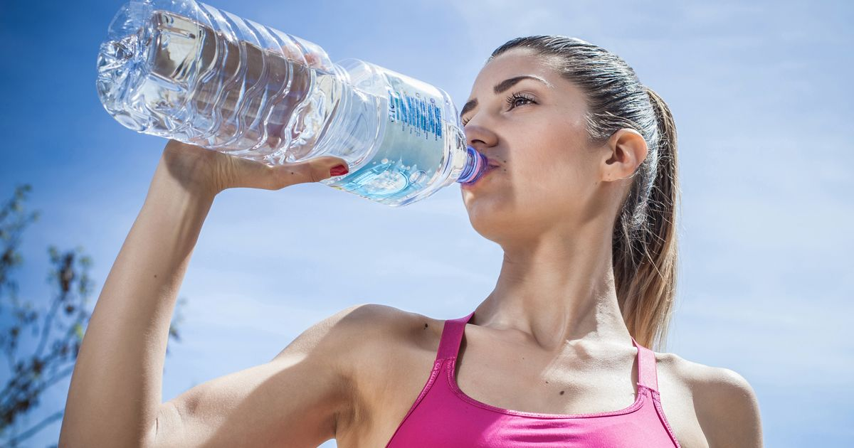 Woman-drinking-water-from-bottle