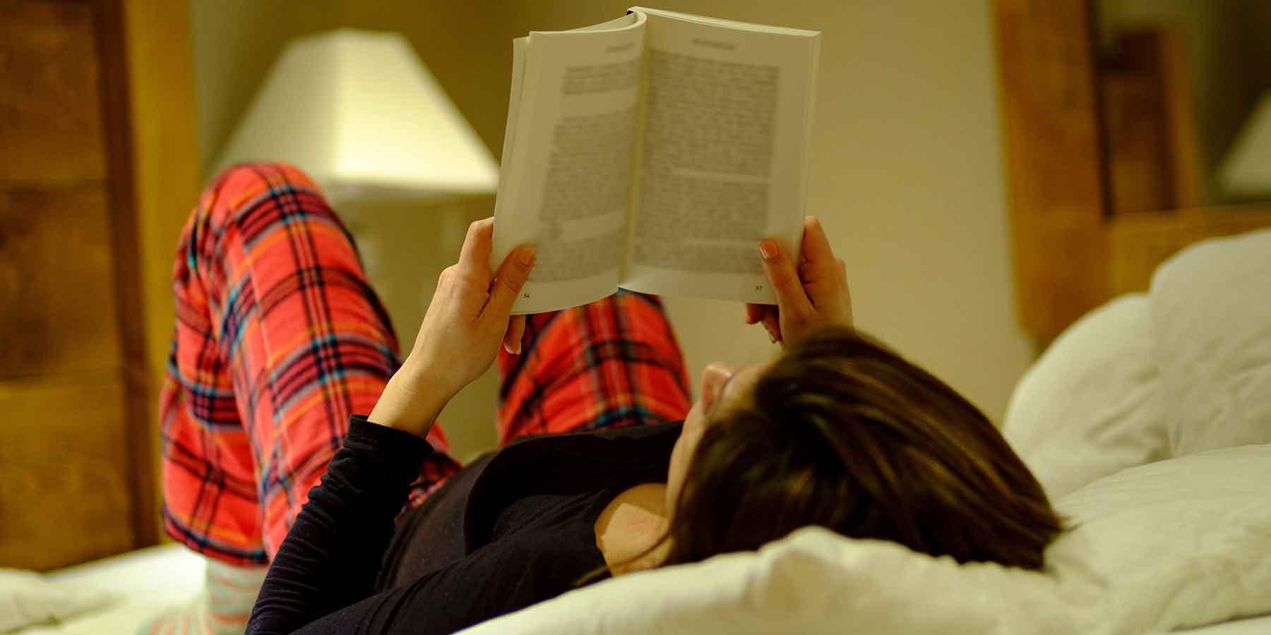Reading books at night before sleeping