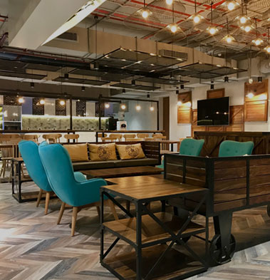 From beer-on-tap to testing an app for a donut, here's how co-working spaces are bidding traditional offices goodbye